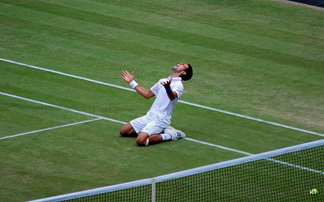 Serbian Novak Djokovic is in ecstasy after winning the semi-final of the 2011 Wimbledon. He would go on to lift the trophy after defeating Spaniard Rafael Nadal in the final. Image courtesy of Wikipedia Foundation